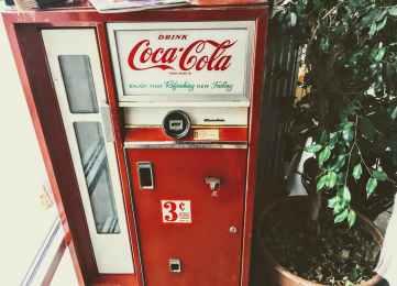 red and white coca cola vending machine