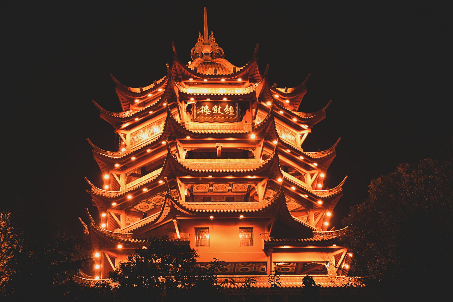 lighted pagoda at night